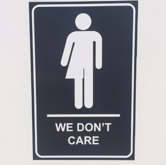 "Bathroom Signs Edmonton people are loving these ""we don't care"" bathroom signs posted"
