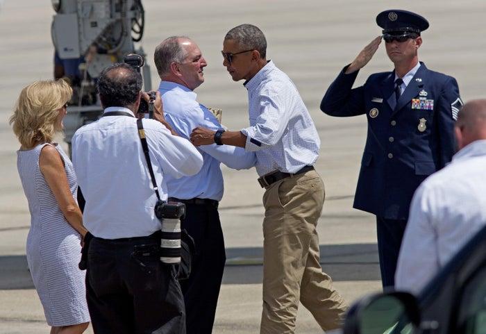 President Barack Obama shakes hands with Louisiana Gov. John Bel Edwards