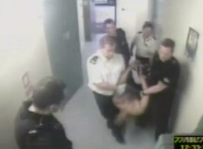 CCTV footage shows 25-year-old Jacob Michael being restrained by police officers before he died. An inquest into his death concluded that he died from a controversial medical condition called excited delirium.
