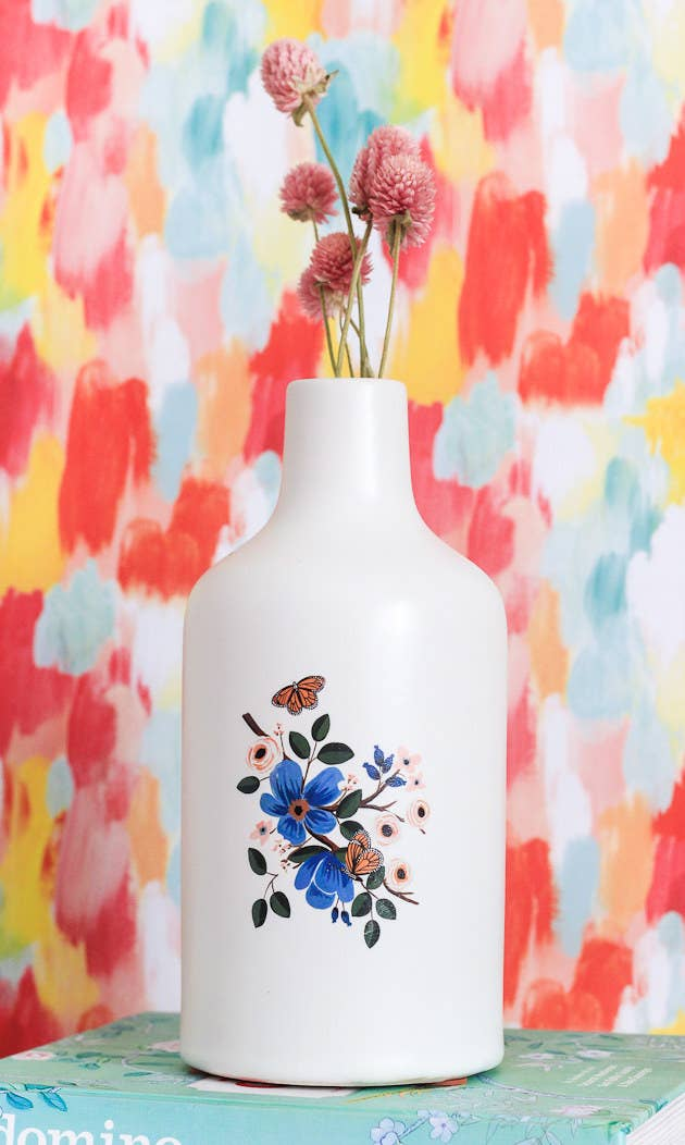 You apply as usual, but even if you a seal with a coat of decoupage, you'll want to always make sure to gently hand-wash the final vase. Find this and tons of other temporary tattoo designs at Tattly. Here's the tutorial.