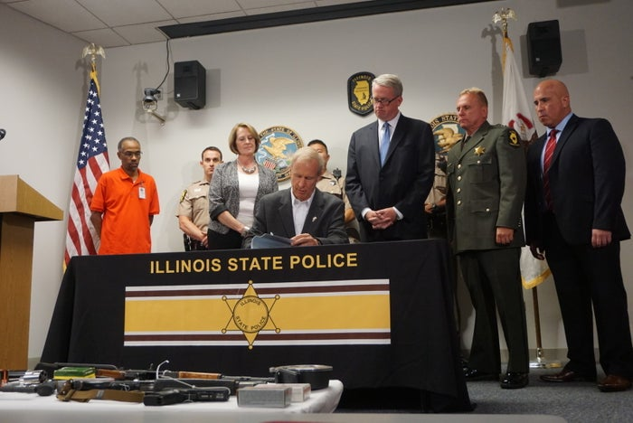 Governor Bruce Rauners signs a new gun trafficking law at Illinois State Police headquarters on Tuesday, August 23.