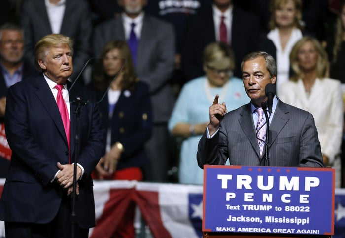 Donald Trump, left, listens to outgoing UKIP leader Nigel Farage speak during a campaign rally at the Mississippi Coliseum in Jackson, Aug. 24, 2016.