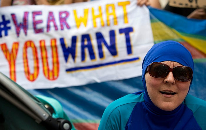 "A woman wearing a burkini at a ""Wear what you want beach party"" protesting the French ban on burkinis outside the French Embassy in London, Aug. 25."