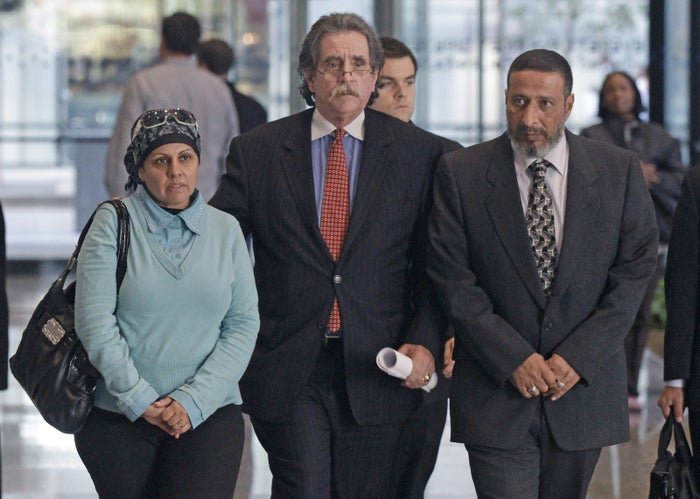 Attorney Thomas Durkin, center, leads Adel Daoud's parents through a federal courthouse.