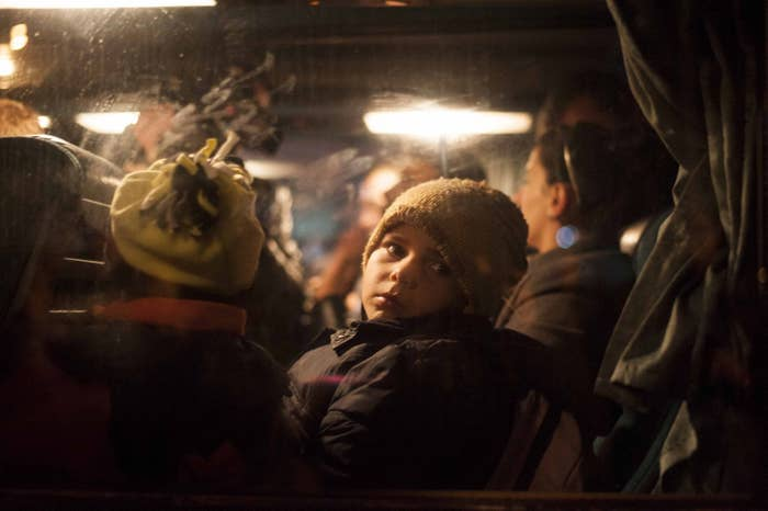A Kosovo Albanian child with his family making their way to Serbia, where they hoped to claim asylum in the EU, in 2015.