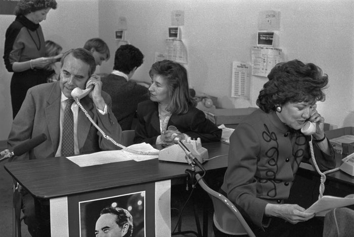 Bob and Elizabeth Dole work the telephones at his headquarters in 1988, eight years before Goldberg joined his next presidential campaign.