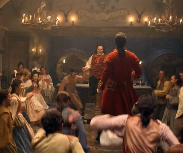 "And here's footage of live-action Le Fou (played by Josh Gad) and towering Gaston (played by Luke Evans) singing the ""Gaston"" song."""