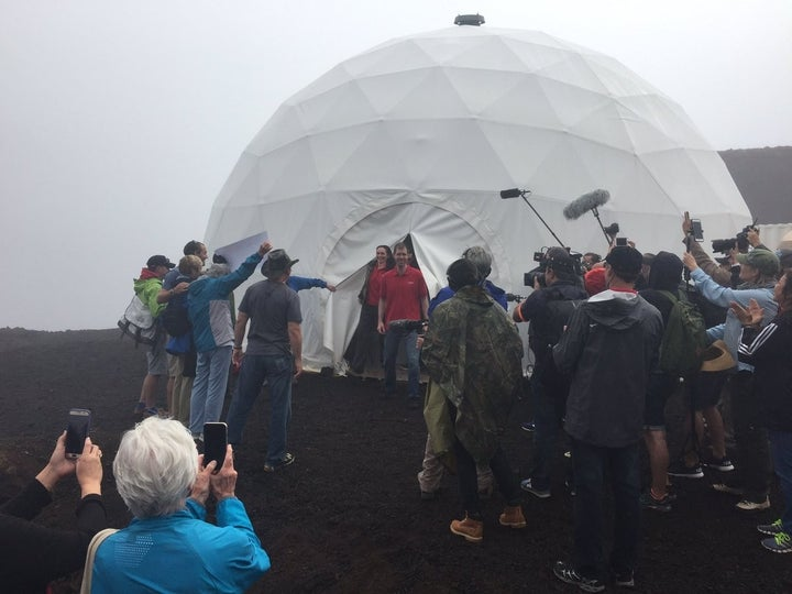 Six scientists on Sunday completed a yearlong isolation mission in a geodesic dome that they could only leave while wearing spacesuits.