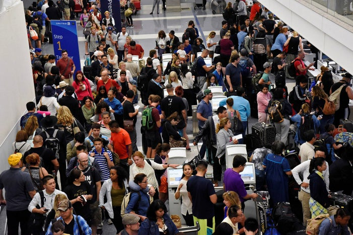 Delayed passengers inside Terminal 7 at Los Angeles International Airport on Sunday night.