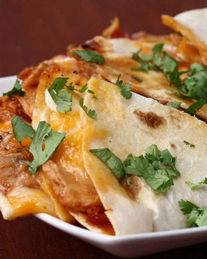 Servings: 1- 2 quesadillasINGREDIENTS1/2 pound chicken breast, cut into stripsSalt, to tastePepper, to taste½ cup BBQ sauce2 flour tortillas¼ cup red onion, julienned1/2 cup monterey jack cheese (double for 2 quesadillas)1/2 cup cheddar cheese (double for 2 quesadillas)GARNISHParsleyBBQ saucePREPARATION1. In a large skillet, add chicken breast and season both sides with salt and pepper. Cook 15-18 minutes, flipping halfway and adding the onions when you flip the chicken. (Cooking times may vary depending on thickness of the chicken breast).2. Remove the chicken from the pan and shred with a fork.3. Return the shredded chicken to the pan with the onions. Add the BBQ sauce and stir. Remove from the pan and set aside.4. Place a tortilla in a pan and add a layer monterey jack and cheddar cheese on half of the tortilla.5. Place cooked chicken and onions, and top with the rest of each cheese. Fold in half and cook 6 minutes, flipping halfway.6. Serve with extra BBQ sauce & enjoy!