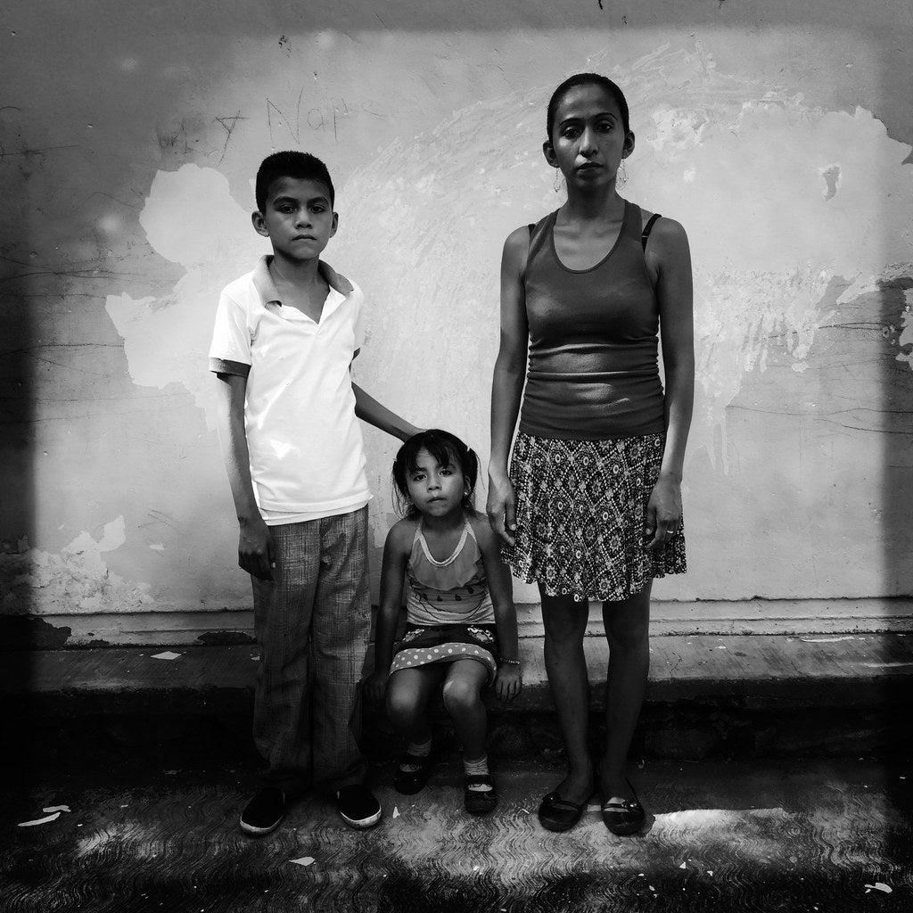 Edith Gabriela Santiago, 31 and children Edwin,10, and Margaret, 5.