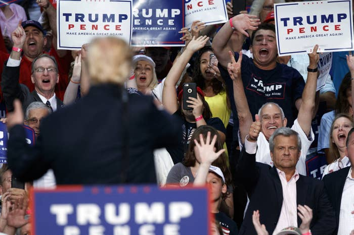 Republican presidential candidate Donald Trump waves to supporters during a campaign town hall in Daytona Beach Wednesday.
