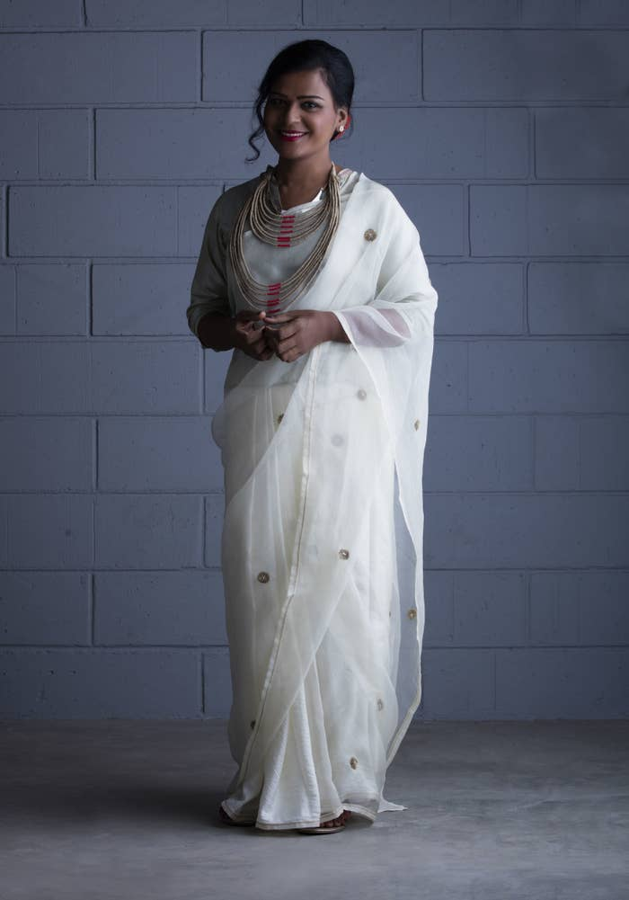 Dressed in a Raw Mango handloom sari and jewelry by En Inde.