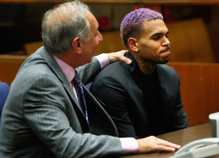Chris Brown appeared with his attorney Mark Geragos at a court hearing in the R&B singer's long-running case over his 2009 attack on Rihanna in March 2015.