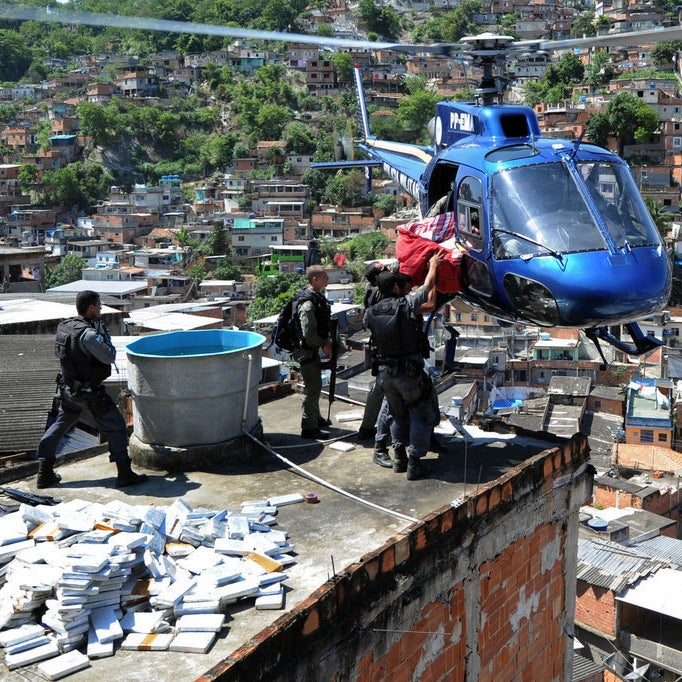 Riot Special Forces police airlift six tons of marijuana found in a bunker during a raid in the Morro do Alemao shantytown on November 28, 2010.