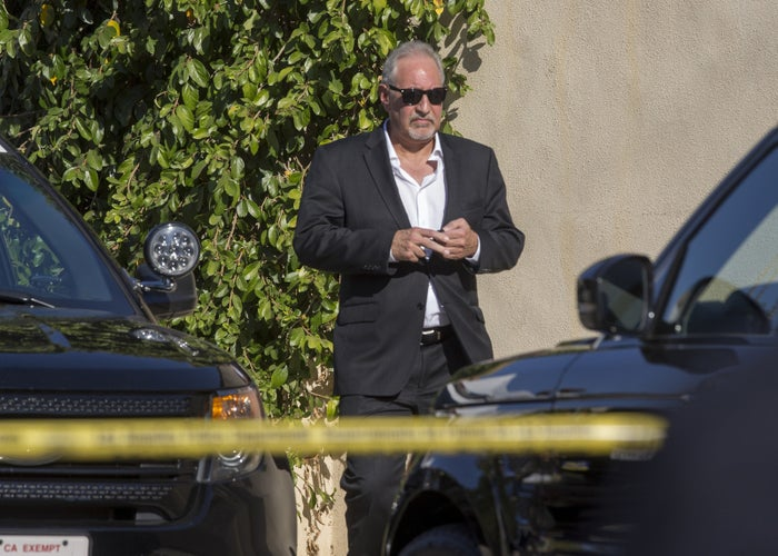 Singer Chris Brown's attorney Mark Geragos leaves the property on Tuesday.