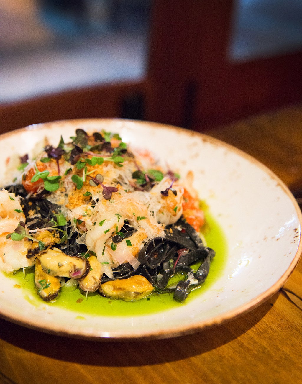 Squid ink tagliatelle with mussels, shrimp, parmigiano-reggiano, and infused chive oil at Red Pump.