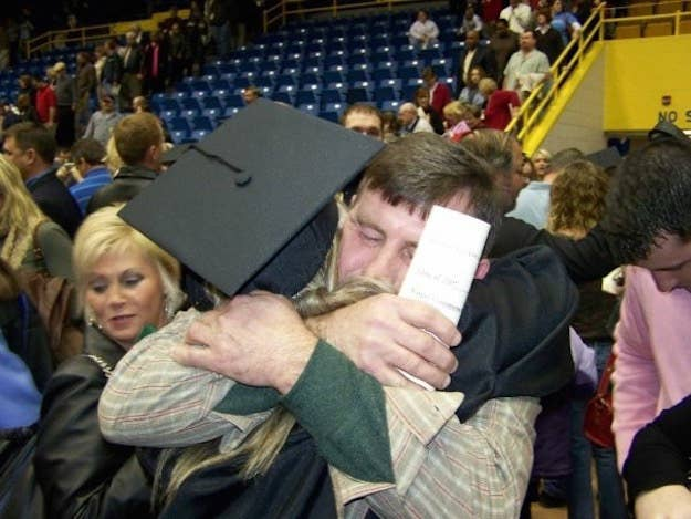 Brittany Combs hugging a family member at her graduation from Morehead State University in 2007.
