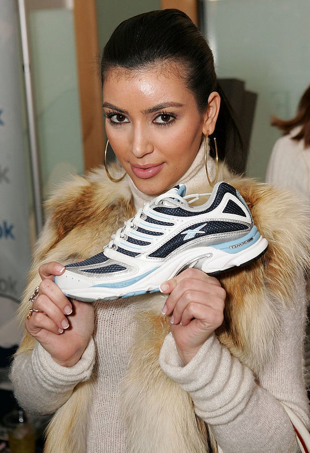 Pose for a photo while holding a single sneaker.