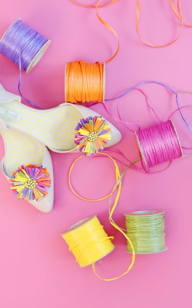 Assemble colorful flowers out of raffia and beads, then glue them to a clip so you can wear them on any pair of shoes you'd like.
