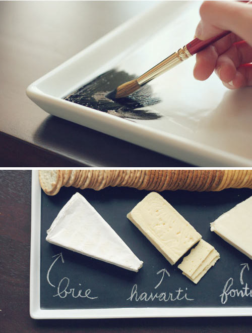 Cover a plain white plate with chalkboard paint, then use it to serve various cheese, crackers, fruit, and whatever else you want to label.