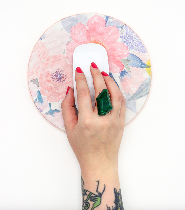 ModPodge your favorite fabric onto a circle (or square, or heart, etc.) of cork to customize a mousepad to your tastes.