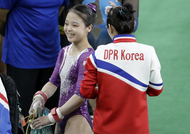 The simple photo at a women's training session is poignant because gymnast Lee Eun-ju, left, is from South Korea and her competitor, Hong Un Jong, is from North Korea.