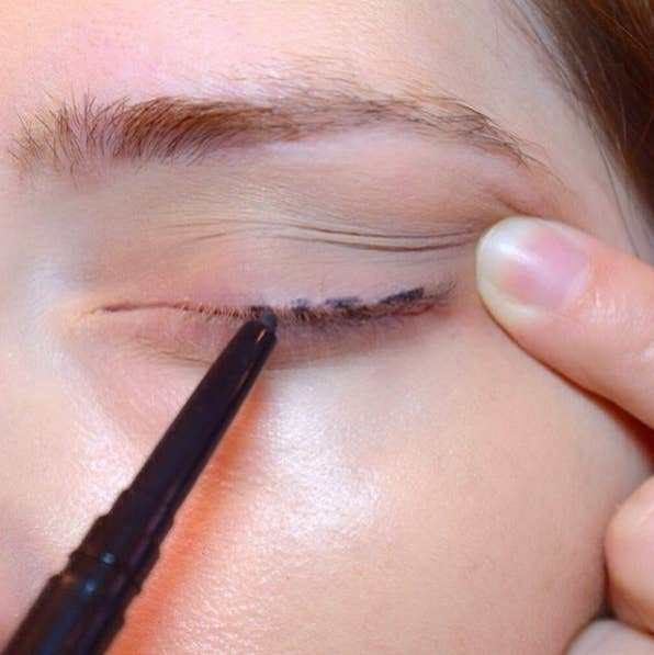 5. For easy eyeliner application, dot your lashes and connect them with a brush to create an even stroke.