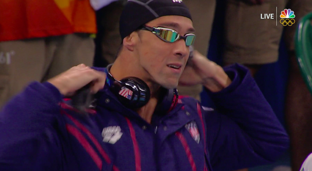 ...and fate struck the hell back, because his cap SNAPPED AND BROKE. Next to having your goggles leak, your cap breaking before a race is one of the most nerve-wracking things that can happen to a swimmer.