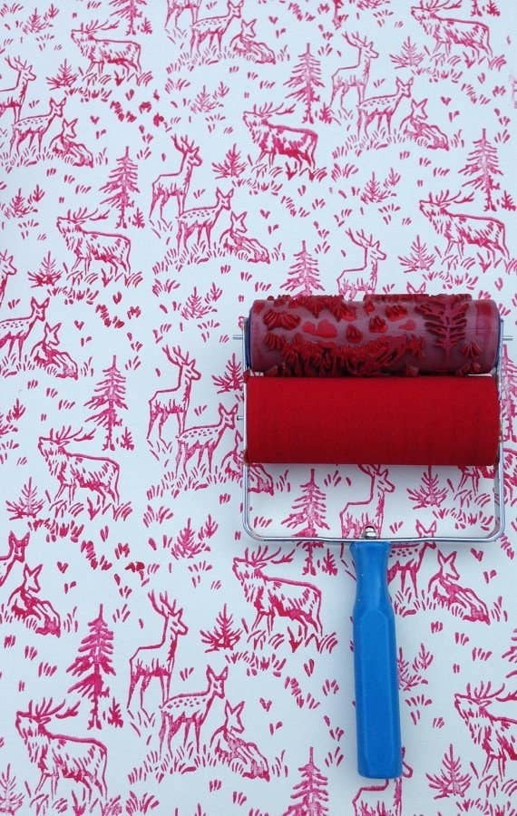 A printed paint roller that will cover your walls with gentle deer and  moose.