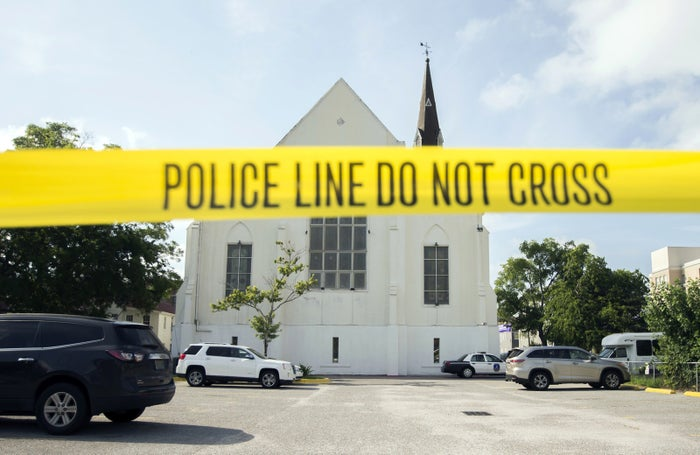 Police tape surrounds the parking lot behind the AME Emanuel Church.