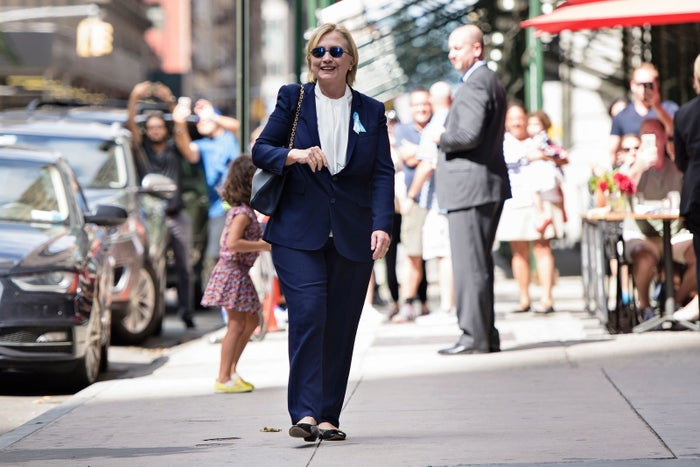 Clinton leaving her daughter's apartment after feeling 'overheated' Sunday.