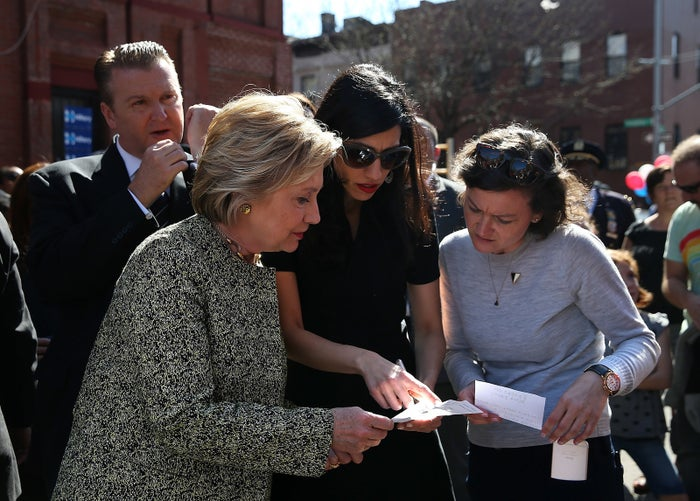 Clinton with aides Abedin (center) and Keigher while campaigning this spring.