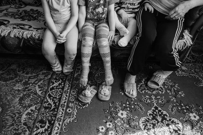 Tatiana, an HIV-infected mother, and her three healthy children at their home in Kramatorsk.