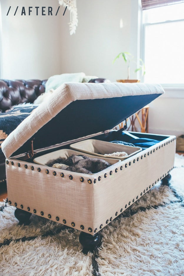 If you have a storage ottoman that seems bottomless and cluttered every time you open it, divide it up with smaller canvas bins.