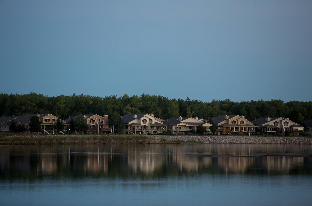 Large houses along the Missouri River in Bismarck, North Dakota.