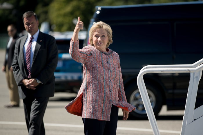 Democratic presidential candidate Hillary Clinton gives a thumbs up Thursday in White Plains, New York while traveling to Greensboro, North Carolina.