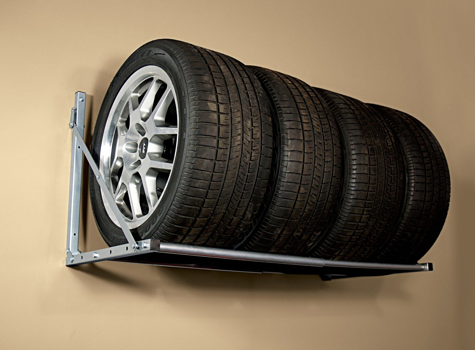 This folding tire loft will hold spares or large storage bins.