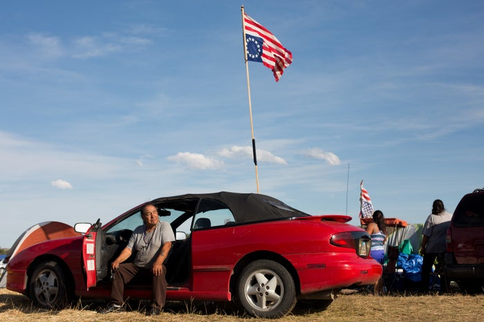 Robert Young, a Lakota from Rosebud, South Dakota at Sacred Stone Camp on Sept. 11, 2016. Young hangs his flags upside down as the international sign of distress, so people will know that there is trouble with the pipeline.