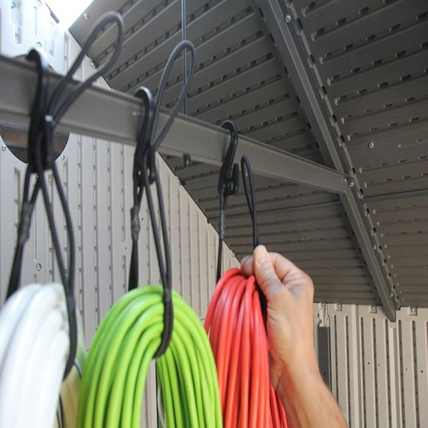 This 3-pack of bungee cords will let you let you wind up extension cords and hang them from the ceiling.