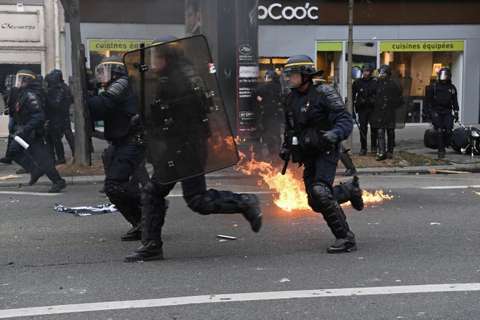 Eight policemen and gendarmes were injured, two with burns from Molotov cocktails.