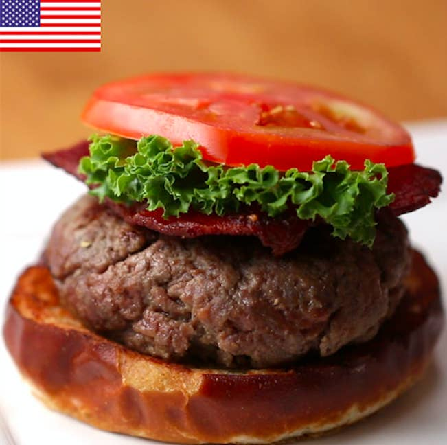 Serves 3 INGREDIENTSAmerican Patty1 pound ground beef, 80% lean1 teaspoon salt½ teaspoon pepper1 teaspoon onion powderToppings2 ounces cheddar cheese, sliced into 3 square chunks1 tablespoon oil3 hamburger buns3 strips bacon, cooked and sliced in half3 slices tomato3 pieces lettucePREPARATION1. Mix together the patty ingredients until evenly combined.2. Flatten the beef into a thin layer, then place a chunk of cheddar inside, wrapping the beef completely around the cheddar. Form a patty with your hands.3. Repeat with the remaining beef and cheese.4. Heat oil in a pan over medium heat.5. Cook the burgers for 3 minutes on the first side, flip, then cook for 6 more minutes.6. Assemble the burgers with the bun, bacon, tomato, and lettuce.Serve!