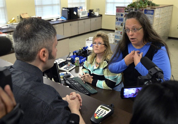 Rowan County Clerk Kim Davis, right, talks with David Moore following her office's refusal to issue marriage licenses in 2015.