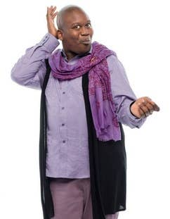 "It seems like Titus wears a lot of purple. His wardrobe seems to be a combination of a bright dress shirt with a black vest or black sports jacket. However, you can also buy his ""Baby Slut"" tee.D&Y Purple Galaxy Print Infinity Scarf - $4.97Nine West Taylor Stretch Long Vest - $69.99Purple dress shirt - $35.99 Men's Baby Slut Baseball T-Shirt - $28.64"