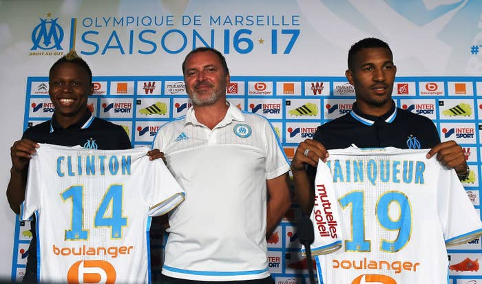 Njie and Vainqueur held up their jerseys and posed for photos with their manager Gunther Jacob.