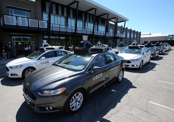 A fleet of Uber's Ford Fusion self driving cars are shown during a demonstration of self-driving automotive technology in Pittsburgh, Pennsylvania, U.S. September 13, 2016.