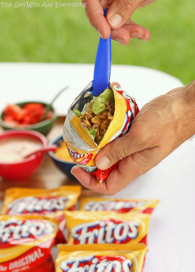 """Get the mini bags of Fritos and have everyone build their own """"taco"""" to their liking."""
