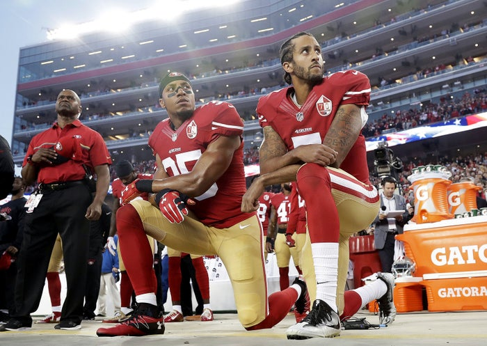 Colin Kaepernick and Eric Reid kneel during the national anthem on Sept. 12.