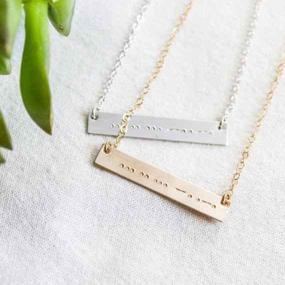 These happen to be in Morse code.Get them from Elle Lane Designs on Etsy for $29.95+ each.