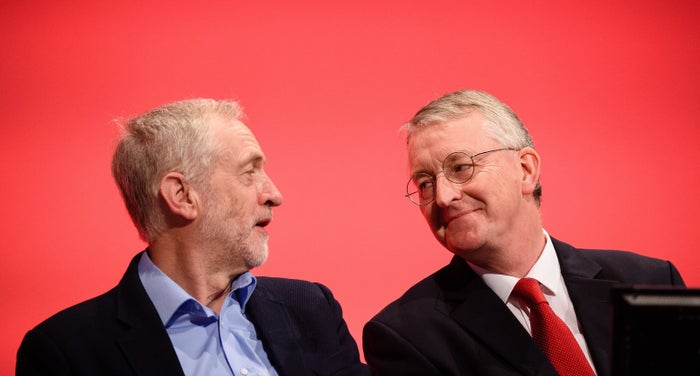 Jeremy Corbyn (L) speaks with with Shadow Foreign Secretary Hilary Benn on day two of the annual Labour party conference in Brighton on 28 September 2015.